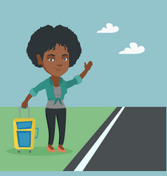 Young african woman with a suitcase hitchhiking vector