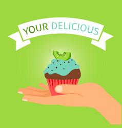 hand holding kiwi cupcake gift vector image