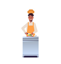 Male professional chef cook chopping fresh vector