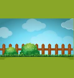 Scene with wooden fence in garden vector image