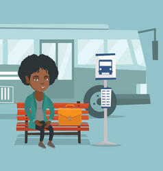 African woman waiting for a bus at the bus stop vector