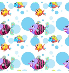A seamless design with a school of colorful fishes vector image