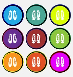 Shoes icon sign Nine multi colored round buttons vector