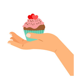hand holding cupcake with two hearts vector image vector image
