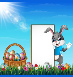 cartoon easter bunny with a basket of easter eggs vector image