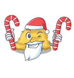 Santa with candy hay bale mascot cartoon vector
