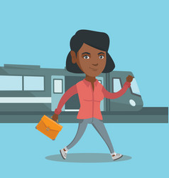 Young woman walking on a railway station platform vector