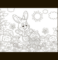 easter bunny with a basket of painted eggs vector image