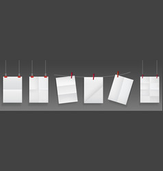 folded posters hang on rope and pins white paper vector image