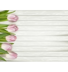 Tulips on wooden background EPS 10 vector image