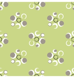 Grunge circles on a light green background vector