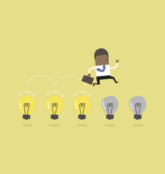 african businessman jump on light bulbs vector image
