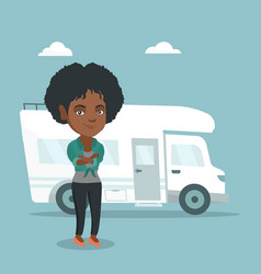 African woman standing in front of motorhome vector