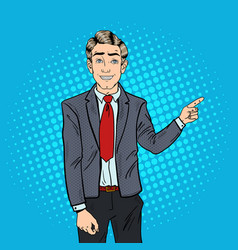 Pop art businessman pointing finger on copy space vector