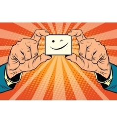 wink Smiley face in hands vector image vector image