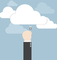 Businessman hand connecting cable to the cloud vector image