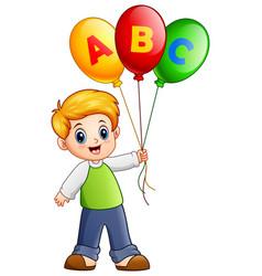 cartoon boy holding alphabet balloon vector image
