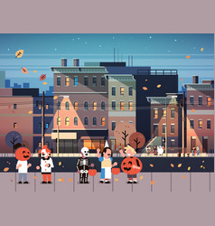 kids wearing monsters costumes walking night town vector image