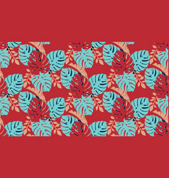 seamless tropical pattern with leaves on a red vector image