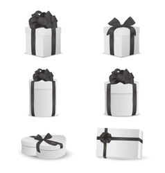 Set of white gift boxes with black bows vector