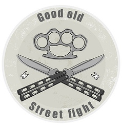 Crossed butterfly knifes with steel brass knuckle vector image