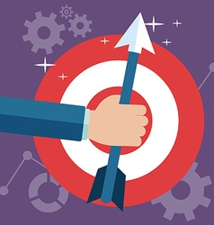 Hand holding arrow on the center red target in vector image vector image