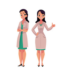 two woman doctors in medical coats standng vector image