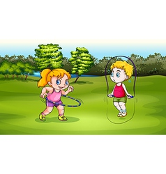 A boy and a girl playing vector image
