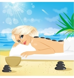 woman getting hot stones treatment vector image
