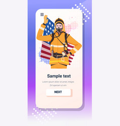 Firefighter in uniform holding usa flag happy vector