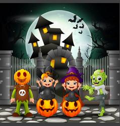 Cartoon happy kids with halloween background vector