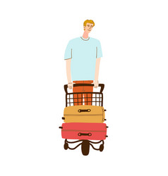 A man walks with luggage on a cart vector
