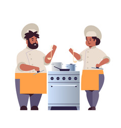 cooks couple professional chefs preparing and vector image