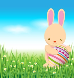 Rabbit and easter eggs on green grass vector image