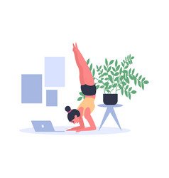 woman practicing yoga at home with laptop on floor vector image