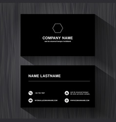 Black paper business namecard on a black wood vector