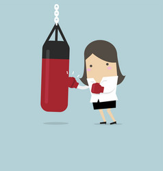 businesswoman wearing boxing gloves with punch bag vector image