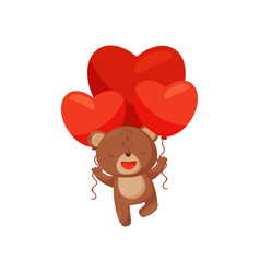 happy brown bear holding bright red balloons in vector image