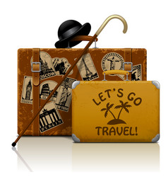 vintage brown threadbare suitcase with collection vector image
