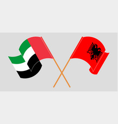 Crossed and waving flags of albania and the united vector