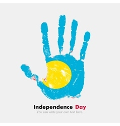 Handprint with the Flag of Palau in grunge style vector image