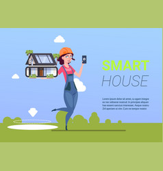 Woman engineer holding smart house vector