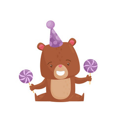 smiling little bear in party hat holding sweet vector image