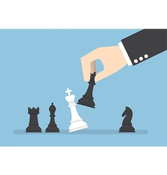 Businessman hand use black queen checkmate vector image vector image