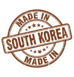 made in south korea brown grunge round stamp vector image