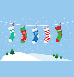 christmas stockings for presents hanging on a rope vector image