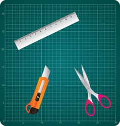 Cutting mat with box cutter ruler and scissors vector