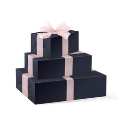 stack of three realistic black gift boxes vector image