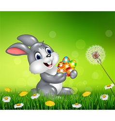 Happy little bunny with colorful Easter eggs vector image