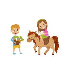 cute litlle girl riding a horse boy standing next vector image